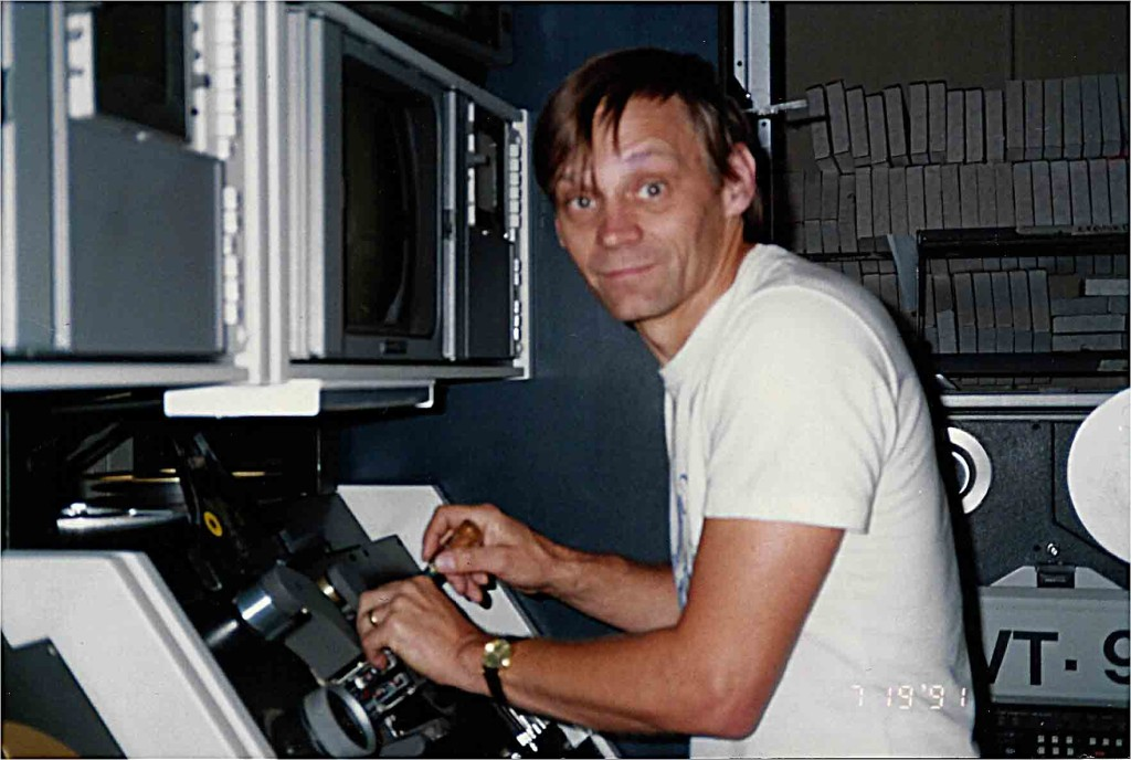 Jon Crick maintaining Ampex videotape machines, about 1990.