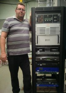 Bill Agresta of Crawford Broadcasting shows off the new KNSN Nautel J1000 transmitter. Photo courtesy Cris Alexander.
